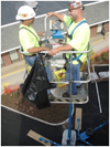 BirdMaster installers in the aerial lift